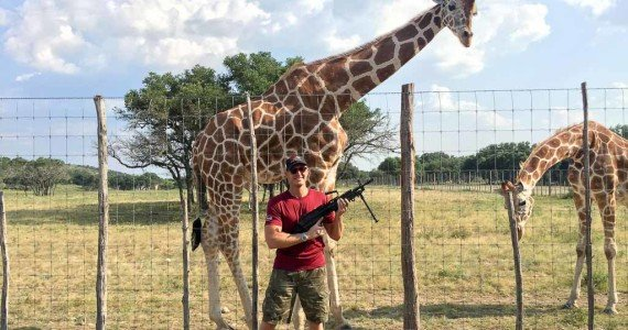 giraffe with a machine gun