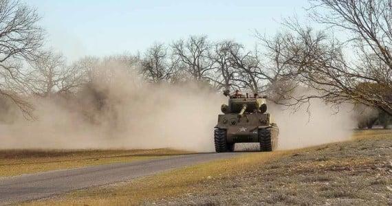 sherman tank driving dust cloud