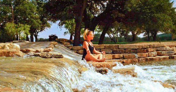 yoga by waterfall